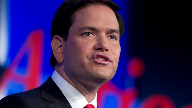 Republican presidential candidate Sen. Marco Rubio, R-Fla., waves to the crowd after speaking at the Values Voter Summit in Washington on Sept. 25, 2015.