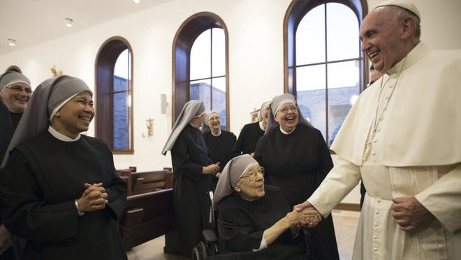 Pope Francis greets nuns of the Little Sisters of the Poor in Washington on Sept. 23, 2015.