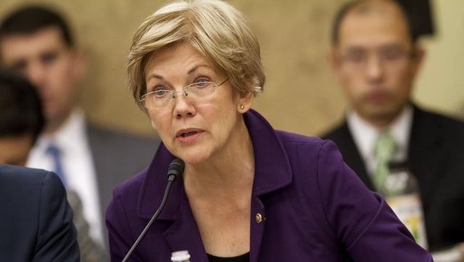 Sen. Elizabeth Warren, D-Mass., speaks on Capitol Hill in Washington, Wednesday, Nov. 18, 2015.