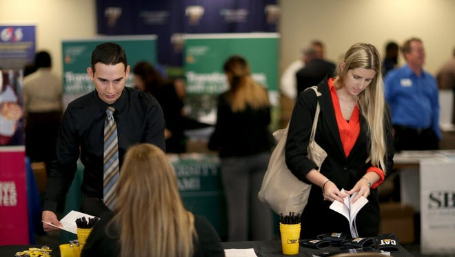 Millennials are the prime targets of hiring managers, according to a LinkedIn survey. Photo shows a career fair in Miami.