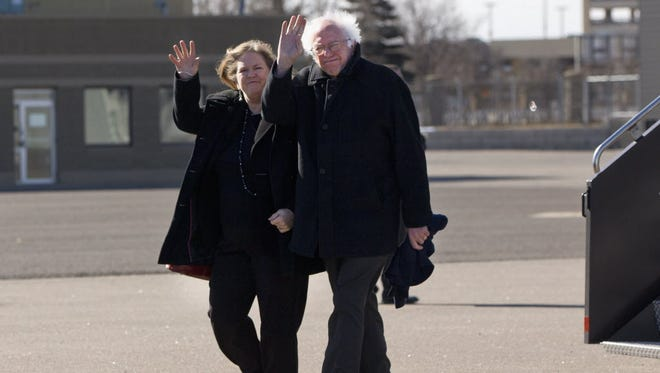Sen. Bernie Sanders, I-Vt. and his wife Jane, wave as they arrive in Minneapolis on Feb. 29, 2016, the day before Super Tuesday's Democratic presidential nomination contests.