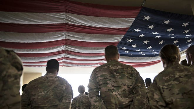 U.S. military personnel are pictured in Afghanistan. A government funding bill passed by the Senate on Friday would increase funding for combat operations in Afghanistan, Iraq and Syria.