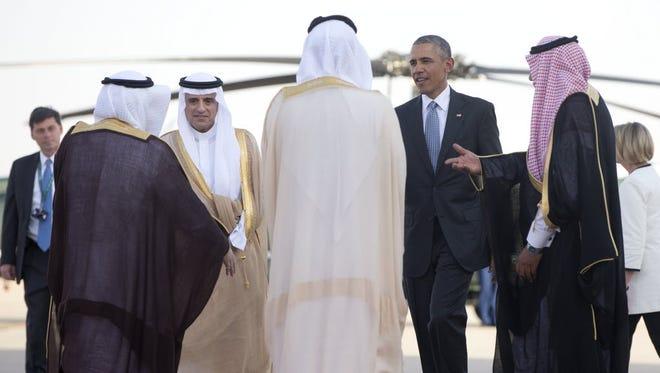 President Obama and Saudi Foreign Minister Adel al-Jubeir are greeted at King Khalid International Airport in Riyadh, Saudi Arabia, April 21, 2016.