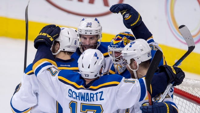 The St. Louis Blues celebrate during their Western Conference semifinals Game 7 rout of the Dallas Stars.