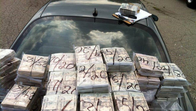According to federal prosecutors, on July 26, 2010, Detroit police discovered $3.3 million in cocaine money stashed in a truck, but only $2.2 million was turned into the evidence room. They allege $1.1 million was stolen by a crew of crooked cops and their cohorts. A photo of the money seized during the raid was shown this week to jurors in U.S. District  Court, where two Detroit police officers and an associate are currently on trial for allegedly stealing drugs and money during raids.