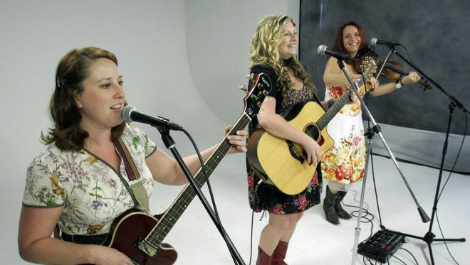 Sara Moilanen (from left), Chrissy Dzioba and Kimberly Unger of the WhiskeyBelles perform in the Tap Milwaukee studios.