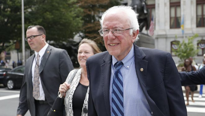 Sen. Bernie Sanders, I-Vt., walks through downtown in Philadelphia on July 28, 2016, during the final day of the Democratic National Convention.