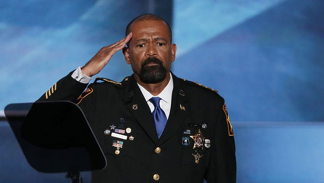 Milwaukee County Sheriff David Clarke salutes the crowd prior to delivering a speech on the first day of the Republican National Convention on July 18 at the Quicken Loans Arena in Cleveland.
