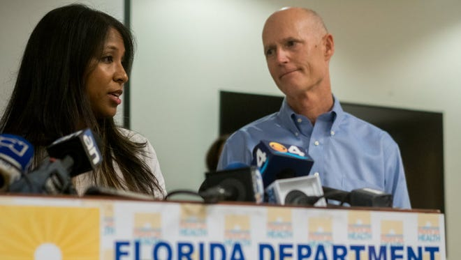 Florida Gov. Rick Scott and Florida Surgeon General Celeste Philip announce five cases of Zika in Miami Beach, Aug. 19, 2016.