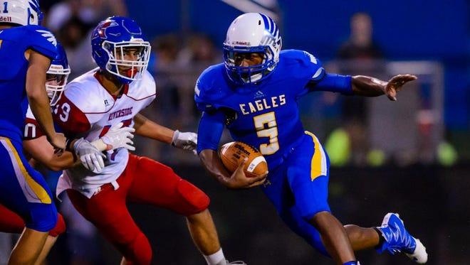 Eastside's TJ Gist (9) on a quarterback draw against Riverside at Eastside High School on Friday night.