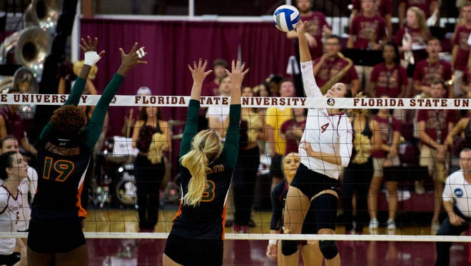 Katie Horton skies for a kill against Miami on Friday night. Florida State swept the Hurricanes and defeated Louisville this week.