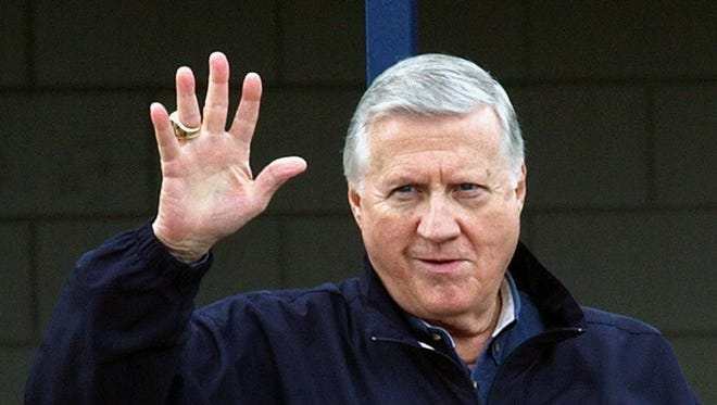 Yankees owner George Steinbrenner waves in this file photo from 2004