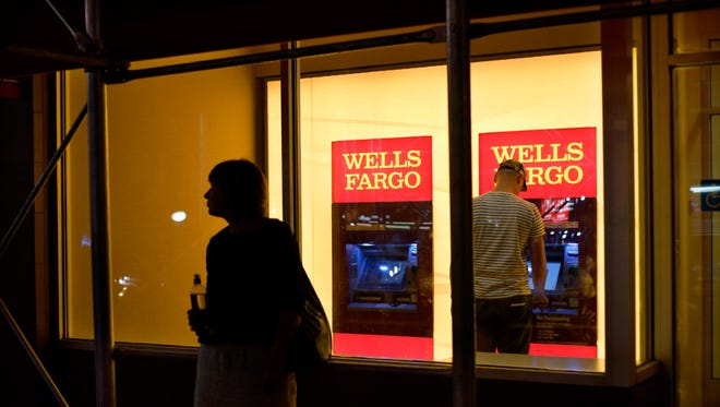 A customer uses a Wells Fargo bank ATM in New York.