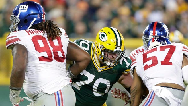 Green Bay Packers guard T.J. Lang (70) blocks against the New York Giants at Lambeau Field.