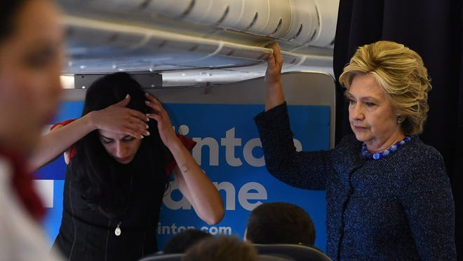 Hillary Clinton and Huma Abedin on their campaign plane in White Plains, N.Y.,  on Oct. 28, 2016.