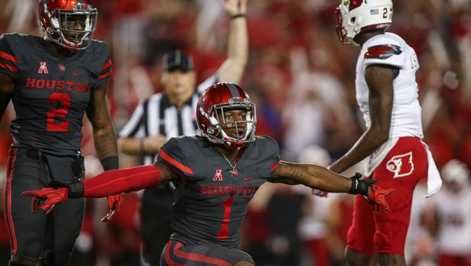 Houston safety Garrett Davis (1) reacts after a play during the first quarter against Louisville.