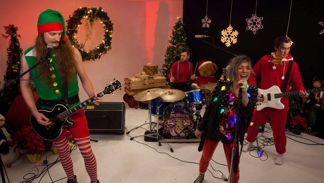 """Milwaukee band Tigernite performs its original Christmas song """"Rock N Roll Pizza Party"""" for a holiday edition of the Milwaukee Journal Sentinel's Sound Check series."""