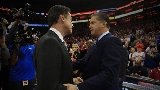 John Calipari and Rick Pitino greet each other before the Kentucky-Louisville game at the KFC Yum! Center on Wednesday, Dec. 21, 2016
