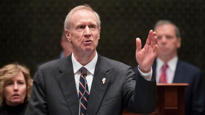 In this Jan. 25, 2017 file photo, Illinois Gov. Bruce Rauner delivers his State of the State address in the Illinois House chamber in Springfield, Ill.  Chicago Public Schools on Tuesday filed a lawsuit against Rauner and the state Board of Education over how Illinois distributes funding for schools.