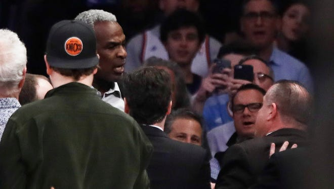 Charles Oakley is confronted by security at Madison Square Garden. The NBA Players' Association's Chris Paul and Michele Roberts spoke up on the Oakley incident on Friday.