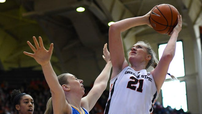Oregon State center Marie Gülich (21) shoots during a game at Oregon State on Feb. 12. Gulich made the go-ahead layup to help Oregon State beat Stanford on Friday.