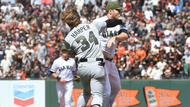 SAN FRANCISCO, CA - MAY 29:  Bryce Harper #34 of the Washington Nationals and Hunter Strickland #60 of the San Francisco Giants throw punches at one another after Strickland hit Harper with a pitch in the top of the eighth inning at AT&T Park on May 29, 2017 in San Francisco, California.  (Photo by Thearon W. Henderson/Getty Images) ORG XMIT: 700011001 ORIG FILE ID: 689831864