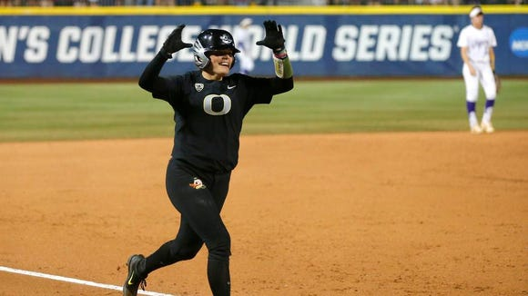 Oregon's Gwen Svekis runs home after hitting a two-run home run against LSU in the first inning of a Women's College World Series softball game in Oklahoma City, Saturday, June 3, 2017. (Bryan Terry/The Oklahoman via AP)