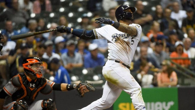 Jonathan Villar, hitting in the leadoff spot, triples and homers during the Brewers' comeback victory over the Giants on Wednesday night at Miller Park.