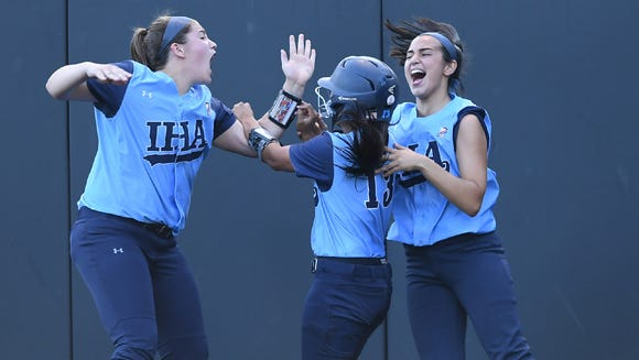 IHA senior CF Reese Guevarra celebrates with her teammates