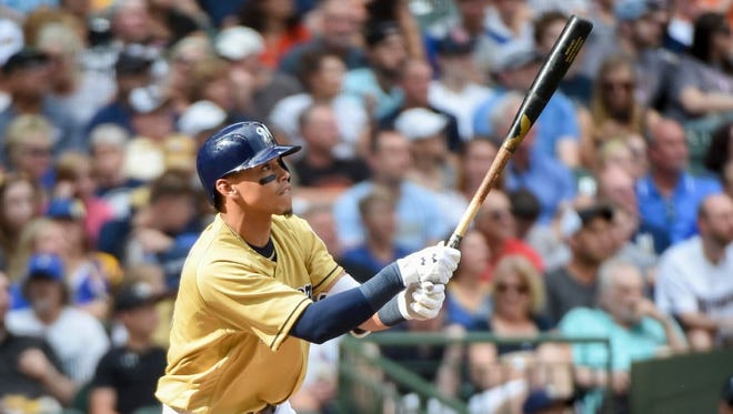 Orlando Arcia of the Brewers watches his solo home run leave the park in center field against the Marlins on Saturday.