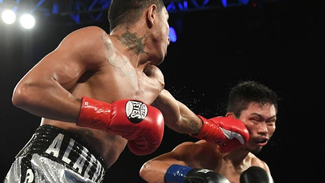 Miguel Berchelt, left, catches Takashi Miura with a left Saturday night.