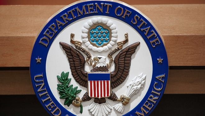 The US Department of State seal is seen on the podium-lectern area November 26, 2013 in the State Department briefing room in Washington, DC.    AFP Photo/Paul J. Richards        (Photo credit should read PAUL J. RICHARDS/AFP/Getty Images)