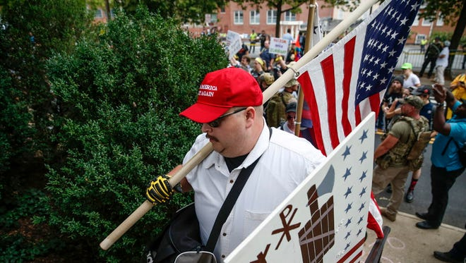 White nationalists make their way into Emancipation Park in Charlottesville, Va., on Aug. 12, 2017.