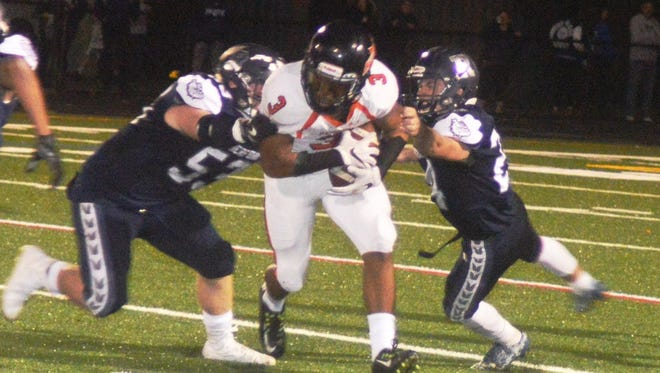 Hasbrouck Heights wide receiver/running back Jasiah Purdie (3) trying to battle through the Rutherford defense.
