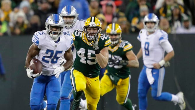Detroit Lions running back Theo Riddick (25) breaks away for a long run down to the 12-yard line against Green Bay Packers outside linebacker Vince Biegel (45) in the fourth quarter Monday, November 6, 2017, at Lambeau Field in Green Bay, Wis.