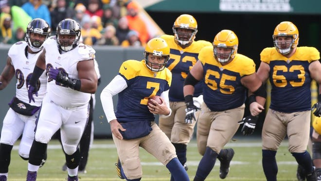 Green Bay Packers quarterback Brett Hundley (7) scrambles for a first down against the Baltimore Ravens Sunday, November 19, 2017 at Lambeau Field in Green Bay, Wis.