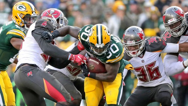Green Bay Packers running back Jamaal Williams (30) runs against the Tampa Bay Buccaneers on December 3, 2017, at Lambeau Field in Green Bay, Wis. The Green Bay defeated Tampa Bay 26-20.