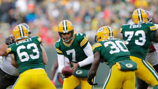Green Bay Packers quarterback Brett Hundley (7) hands the ball off to running back Jamaal Williams (30) against Tampa Bay Sunday, December 3, 2017, at Lambeau Field in Green Bay, Wis.