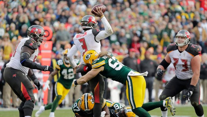 Green Bay Packers outside linebacker Clay Matthews (52) sacks Tampa Bay Buccaneers quarterback Jameis Winston (3) in the fourth quarter at Lambeau Field on Sunday, December 3, 2017 in Green Bay, Wis.