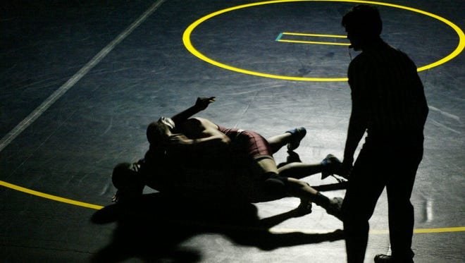 Wrestlers compete.