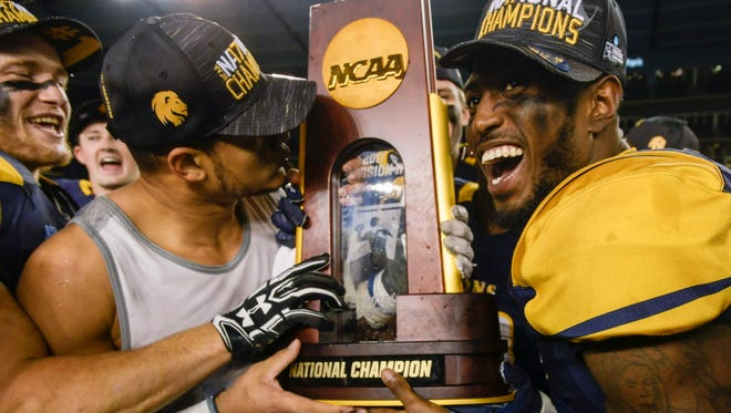 Texas A&M-Commerce defensive back Alex Shillow, right, and teammate Mark Westbrook celebrate their NCAA Division II college football championship win over West Florida.