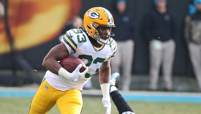 Green Bay Packers running back Aaron Jones (33) breaks into the secondary on a run up the middle against the Carolina Panthers on Sunday, Dec. 17, 2017 at Bank of America Stadium in Charlotte, N.C.