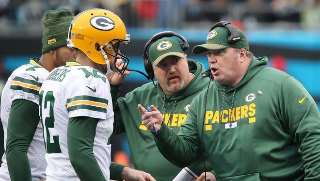 Green Bay Packers quarterback Aaron Rodgers (12) and head coach Mike McCarthy talk during a time out against the Carolina Panthers on Sunday, Dec. 17, 2017 at Bank of America Stadium in Charlotte, N.C.