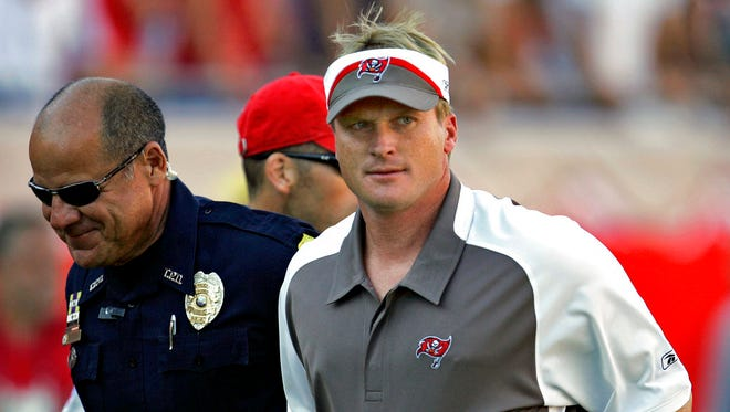 In this Sunday Nov. 4, 2007 file photo, Tampa Bay Buccaneers head coach Jon Gruden, right, leaves the field after an NFL football game against the Arizona Cardinals  in Tampa, Fla. Jon Gruden says he hopes he's a candidate to return for a second stint as coach of the Oakland Raiders and believes a final decision will be made next week.