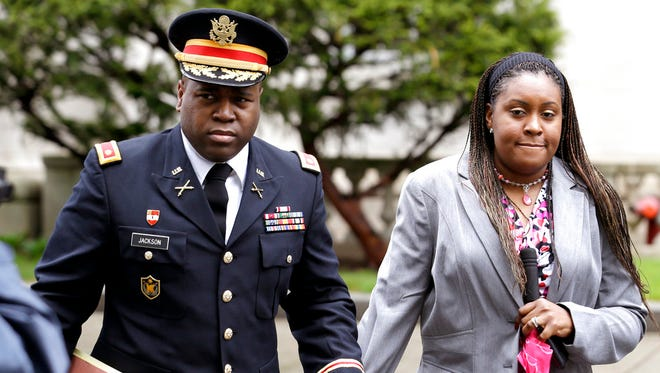In this May 9, 2013, file photo, John Jackson, left, and his wife Carolyn Jackson, of Mount Holly, N.J., walk out of Martin Luther King, Jr. Courthouse in Newark, N.J.