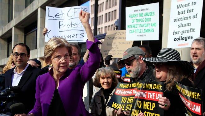 Sen. Elizabeth Warren rallies outside the Consumer Financial Protection Bureau on Nov. 28, 2017.