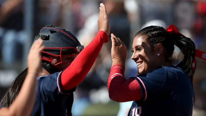 Arizona starting pitcher Taylor McQuillin receives high fives after her two-hit shutout of North Dakota State on Saturday.