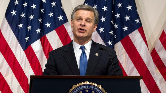 FBI Director Christopher Wray talks about the Clinton email report, FBI headquarters, Washington, June 14, 2018.