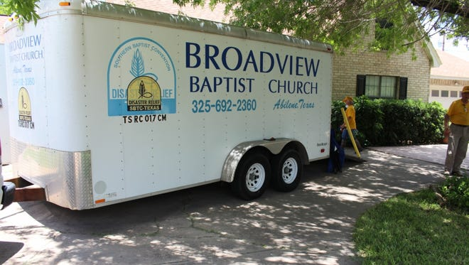 Broadview Baptist Church's trailer outside a flooded home in Mission.