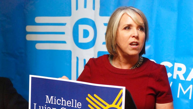 In this June 6, 2018, file photo, New Mexico Congresswoman Michelle Lujan Grisham talks about her Democratic primary election victory in the race for New Mexico governor at a coffee shop in Albuquerque, N.M. New Mexico gubernatorial hopefuls Democrat Rep. Michelle Lujan Grisham and Republican Rep. Steve Pearce are pushing dueling economic plans aimed at tackling poverty in one of the nation's poorest states.